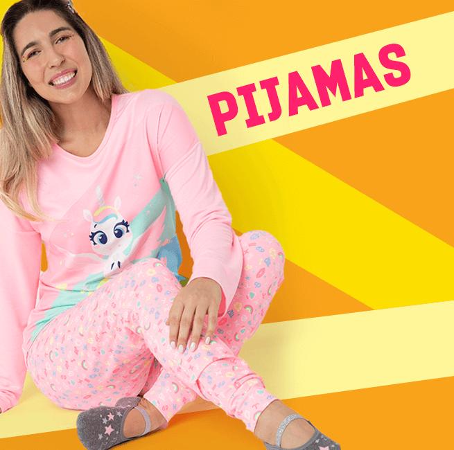 Pijamas! Na imagem temos uma mulher vestindo uma pijama de manga longa de unicórnio.